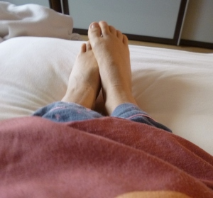 Sticking feet out of bed